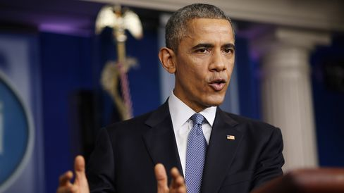 U.S. President Barack Obama speaks to members of the media during his last news conference of the year in the Brady Press Briefing Room at the White House December 19, 2014 in Washington, DC.