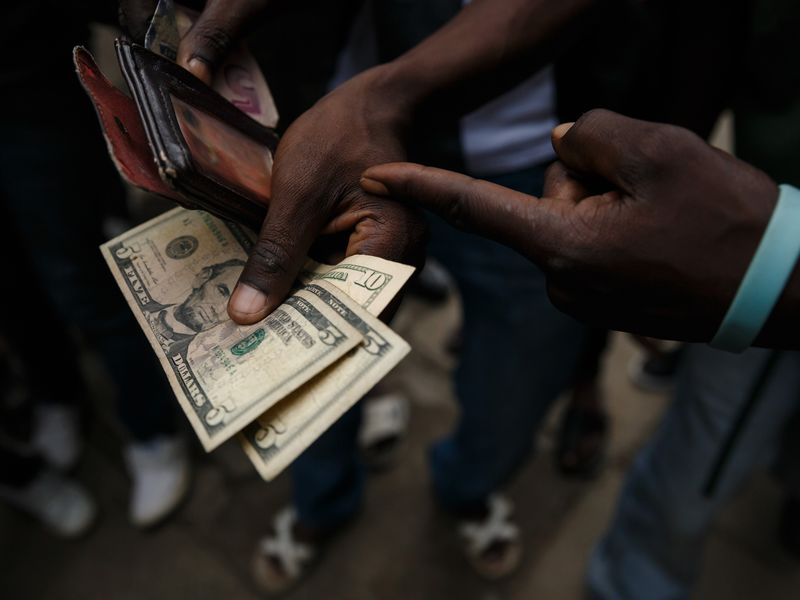 relates to Zimbabwe Central Bank Abolishes Use of Foreign Currencies