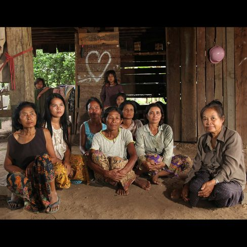 Bu Sonthana, right, sits with other Banmai villagers