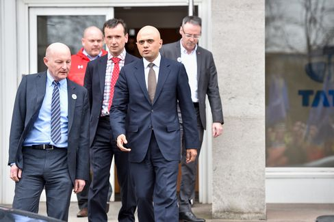 Sajid Javid leaves a meeting with workers at the Tata steel works.