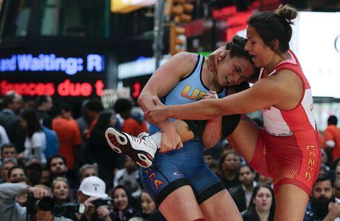 Adeline Gray, left, wrestles Justina Di Stasio