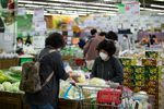 Customers check cabbages at a Hanaro Mart supermarket in Seoul on May 14.