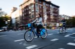 A cyclist rides a Citi Bike in the East Village neighborhood of New York.