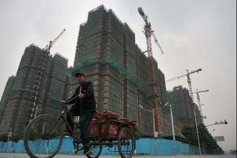 China Policy 'Misinterpretation' Fueled Home Prices, Yi Says