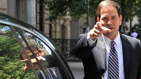 US Senator Marco Rubio, R-FL, points to his car after accidentally getting into the wrong car as he leaves the Council on Foreign Relations May 31, 2012 in New York.