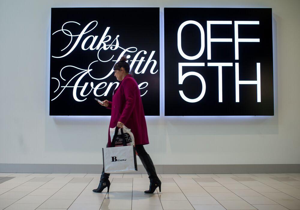 82d33ba49b A shopper walks past a Saks Fifth Avenue OFF 5TH store in Tsawwassen