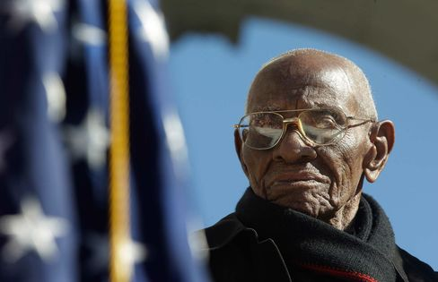 World War II veteran 107 year-old Richard Overton stands up for the presentation of the colors during Veteran Day ceremony at Arlington National Cemetery Amphitheater, Monday, Nov. 11, 2013 at Arlington National Cemetery in Arlington, Va.