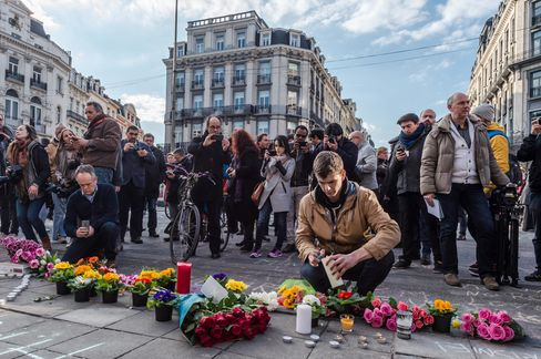 People light candles in Brussels on Tuesday.
