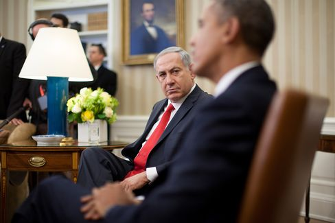 Benjamin Netanyahu, Israel's prime minister, left, looks on as U.S. President Barack Obama speaks in the Oval Office of the White House in Washington, D.C., on March 3, 2014.
