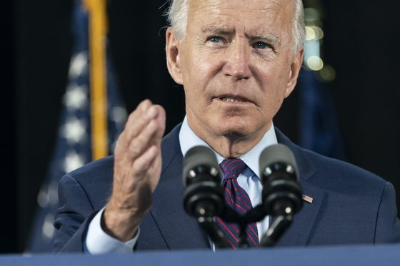 Biden to Map Economic Path Delaying Progressives' Biggest Plans