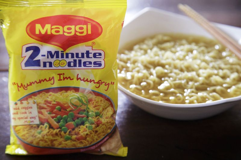 A packet and a cooked bowl of Maggi 2-Minute Noodles.