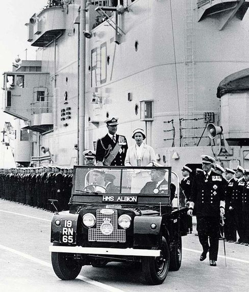 Queen Elizabeth II and The Duke of Edinburgh take a ride in a Series II during a royal tour in 1957.