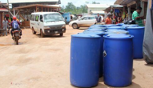 Fuel barrels sit near outdoor markets in Mabaruma.