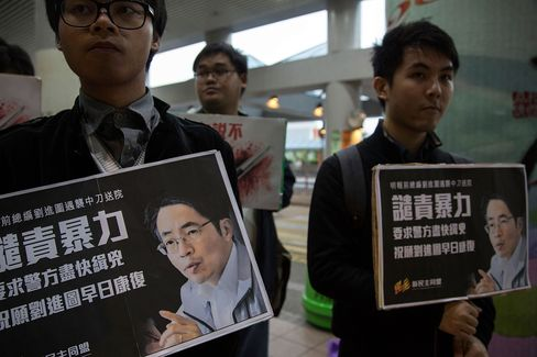 Placards Showing Support for Ming Pao Former Chief Kevin Lau