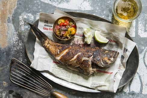 Pan-fried sea bass served with a tomato relish, a recipe from Thiam's book.