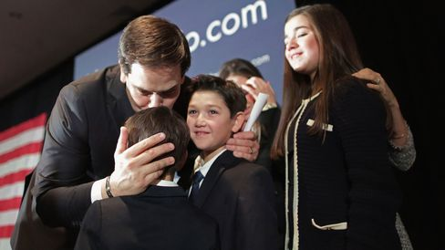 Republican presidential candidate Marco Rubio kisses his sons after delivering remarks on Feb. 9, 2016, in Manchester, New Hampshire.