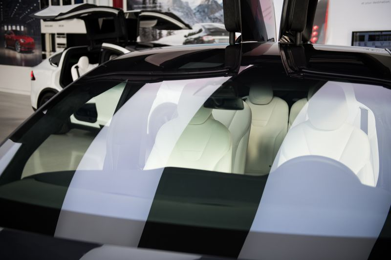Lights Reflect On The Windshield Of The Tesla Model X P100D At The New  Tesla Inc. Showroom In New York.