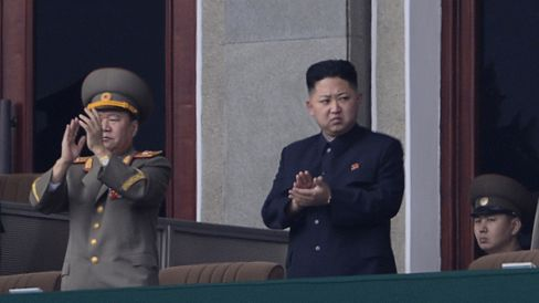 North Korean leader Kim Jong-Un applauds during a official ceremony at a stadium in Pyongyang on April 14, 2012.