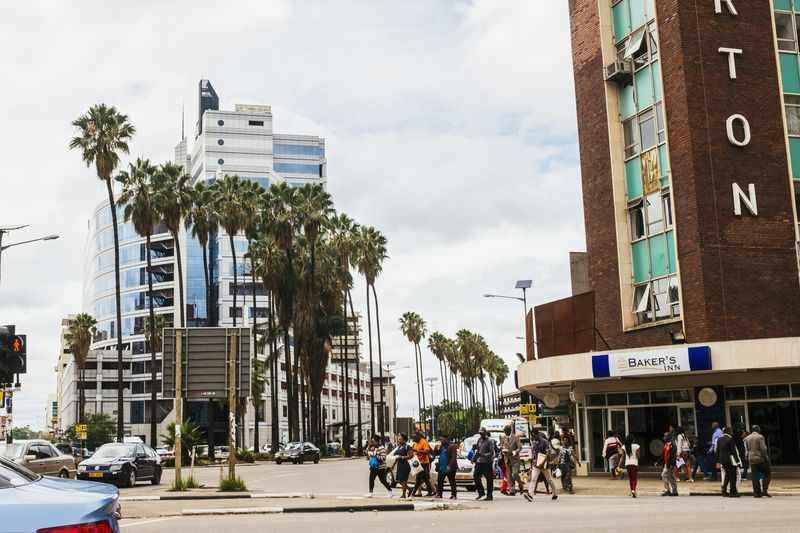 Pedestrians in downtown Harare, Zimbabwe.