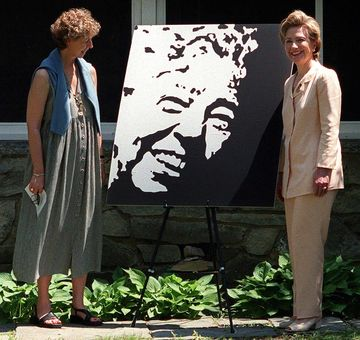 US First Lady Hillary Clinton (R) and Anne Roosevelt (L), granddaughter of late US First Lady Eleanor Roosevelt, unveil a portrait of Eleanor Roosevelt at Val-Kill in Hyde Park, New York 17 June 2000. Mrs. Clinton visited the Val-Kill Cottage home of Eleanor Roosevelt to announce that 150,000 USD in private donations had been raised to help preserve the nation's only historic site dedicated to a first lady.