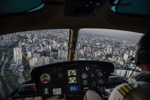An UberCopter flies above São Paulo.
