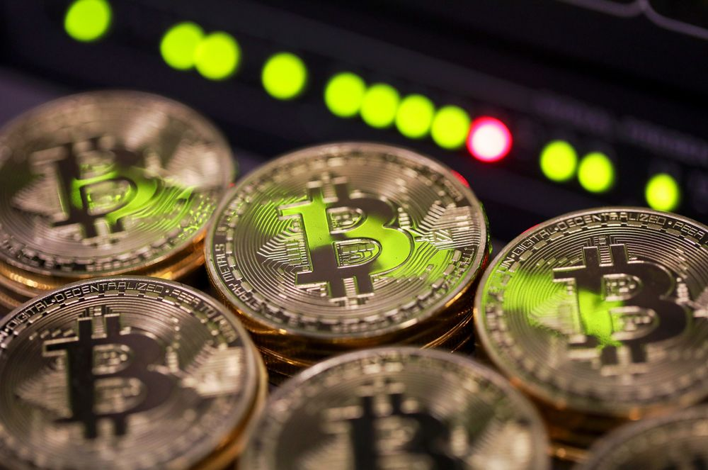 Stacks Of Bitcoins Sit Near Green Lights On A Data Cable Terminal Inside Communications Room