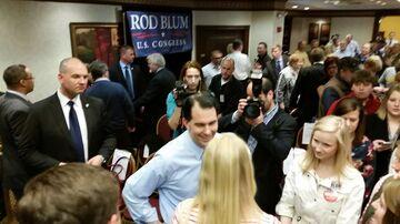 Scott Walker meets with Republicans after an appearance in Cedar Rapids, Iowa, on April 24, 2015.