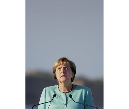 German Chancellor Angela Merkel looks skywards during a news conference onboard the Italian aircraft carrier Giuseppe Garibaldi following talks off the coast of the island of Ventotene, Italy.
