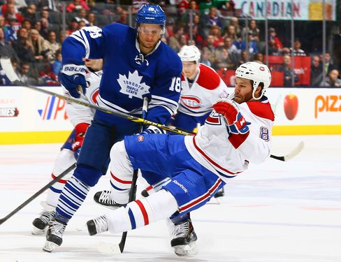 Richard Panik #18 of the Toronto Maple Leafs runs into Brandon Prust #8 of the Montreal Canadiens during NHL action at the Air Canada Centre April 11, 2015 in Toronto, Ontario, Canada.