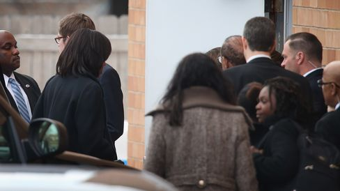 First lady Michelle Obama (left) ducks in a side door after arriving at the Greater Harvest M.B. Church for the funeral of 15-year-old Hadiya Pendleton on Feb. 9, 2013, in Chicago.