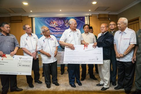Najib Razak at at a cheque presentation ceremony in Sarawak in April 2016.