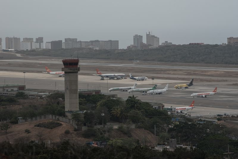 Airplanes sit on the tarmac at Simon Bolivar International Airport in Maiquetia, Venezuela, on May 8, 2018.