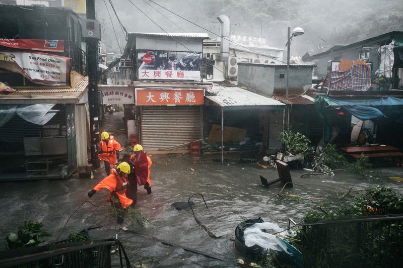 Firefighters Escort People Through Floodwaters During A No  Hurricane Signal In Hong Kong On Sept  Photographer Anthony Kwan Bloomberg