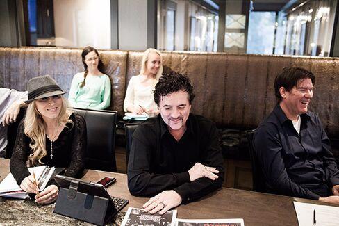 Borchetta (center) and wife, Sandi (left), in Big Machine's Nashville office