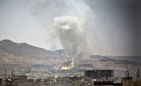 Smoke rises after a Saudi-led airstrike hit a site where many believe the largest weapons cache in Yemen's capital, Sanaa, on April 21, 2015.