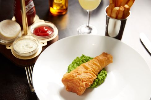 Fried cod on mushy peas, done right at The Clocktower.