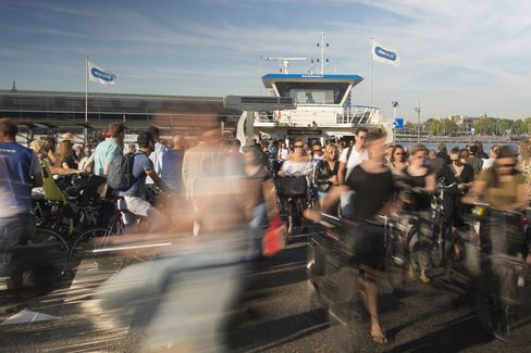 Passengers disembark from a ferry at Amsterdam Noord