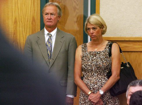 Governor Lincoln Chafee and his wife, Stephanie, stand as their son, Caleb Chafee, is sentenced on Aug. 22, 2012, in Washington County Court in South Kingstown, Rhode Island.