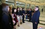 Kim Jong Un talks to South Korean artistic group, including the mebmers of the popular girl band Red Velvet.