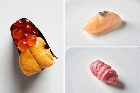 Clockwise from left: sea urchin with salmon roe, scallop, and hagitoro (tuna) nigiri.