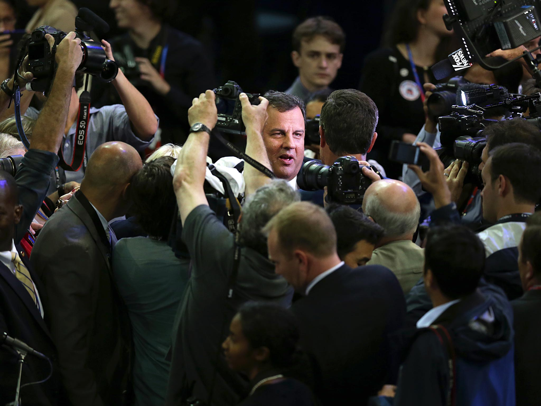 Chris Christie, governor of New Jersey, center, is swarmed by the media at the Republican National Convention in Tampa in 2012.