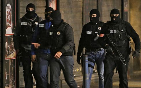 Members of French police special forces in Saint Denis