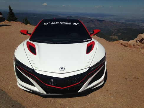 The 2016 Acura NSX is a hybrid that runs on a 6-cylinder engine paired with three electric motors.