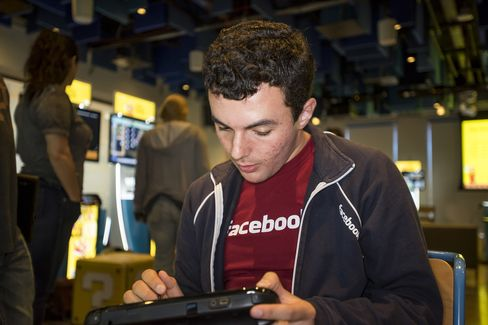 Facebook employee Gregory Rose uses a Wii U game console as he participates in a hackathon creating new levels for Super Mario Maker at the Facebook headquarters in Menlo Park, Calif., on July 29, 2015.
