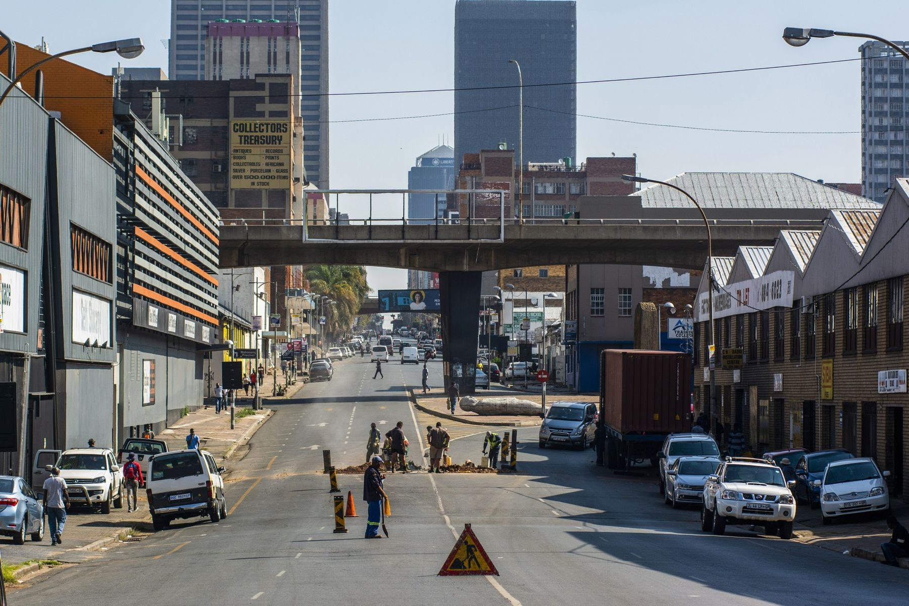 Municipal workers labour at a roadworks site in the Central Business District (CBD) of Johannesburg.
