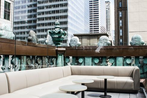 Inside St. Cloud's northwest Skypod. This private lounge seats 18 people and overlooks 42nd street and Broadway.