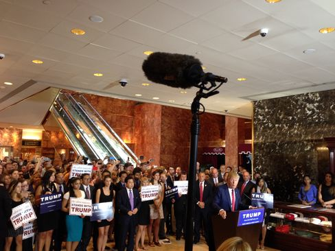 Donald Trump addresses a crowd at Trump Tower on Sept.3, 2015.