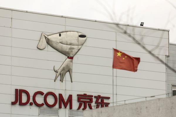 JD.com Delivery Drivers as Company Reports Fourth-Quarter Earnings