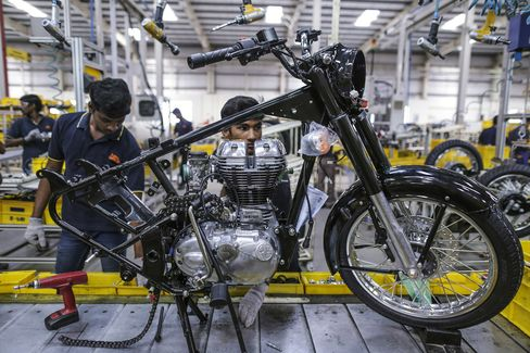 Employees assemble a Royal Enfield Motors Ltd. Classic 350 motorcycle in Chennai, India.