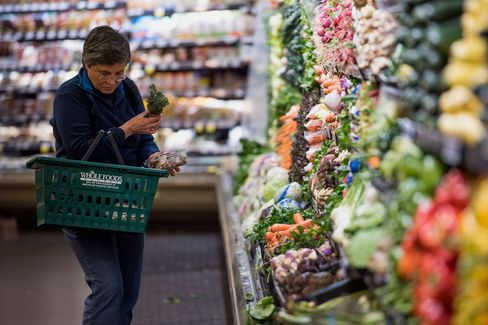 A customer shops for produce at a Whole Foods Market Inc. store in Oakland, Cali., on May 6, 2015.